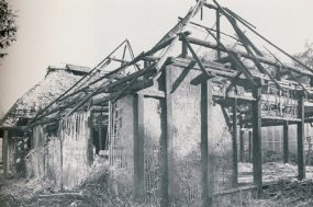the damaged Ota House after the fire in 1990